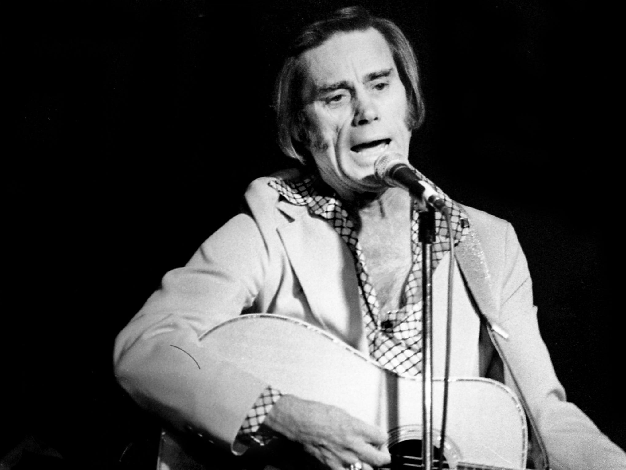 George Jones is performing one of his hits at his widely-anticipated comeback appearance at the Exit/In on April 6, 1979. The Possum, who had to declared bankruptcy because of $1.5 million in debts, has troubled years of missed concert dates, and wide-spread talk of a drinking problem has soured his once-brilliant career.