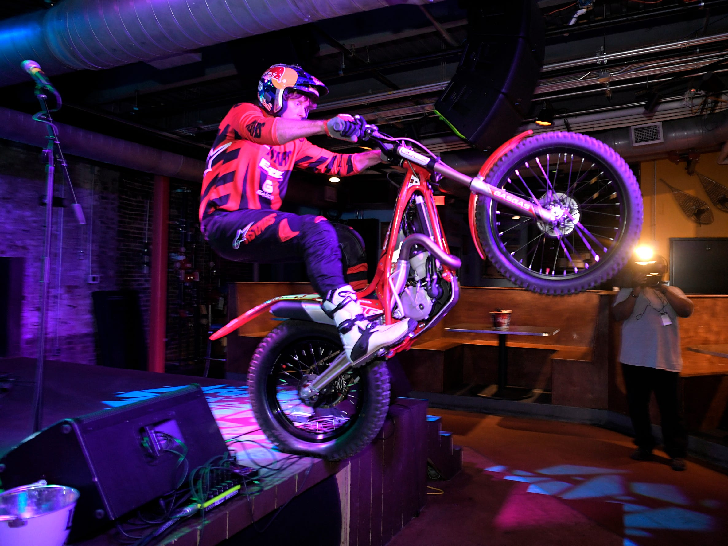 Trial motorcyclist Geoff Aaron performs stunts in the Tin Roof on Broadway on Thursday, April 4, 2019. The trials and endurocross legend is in town for the Motocross-Supercross event.