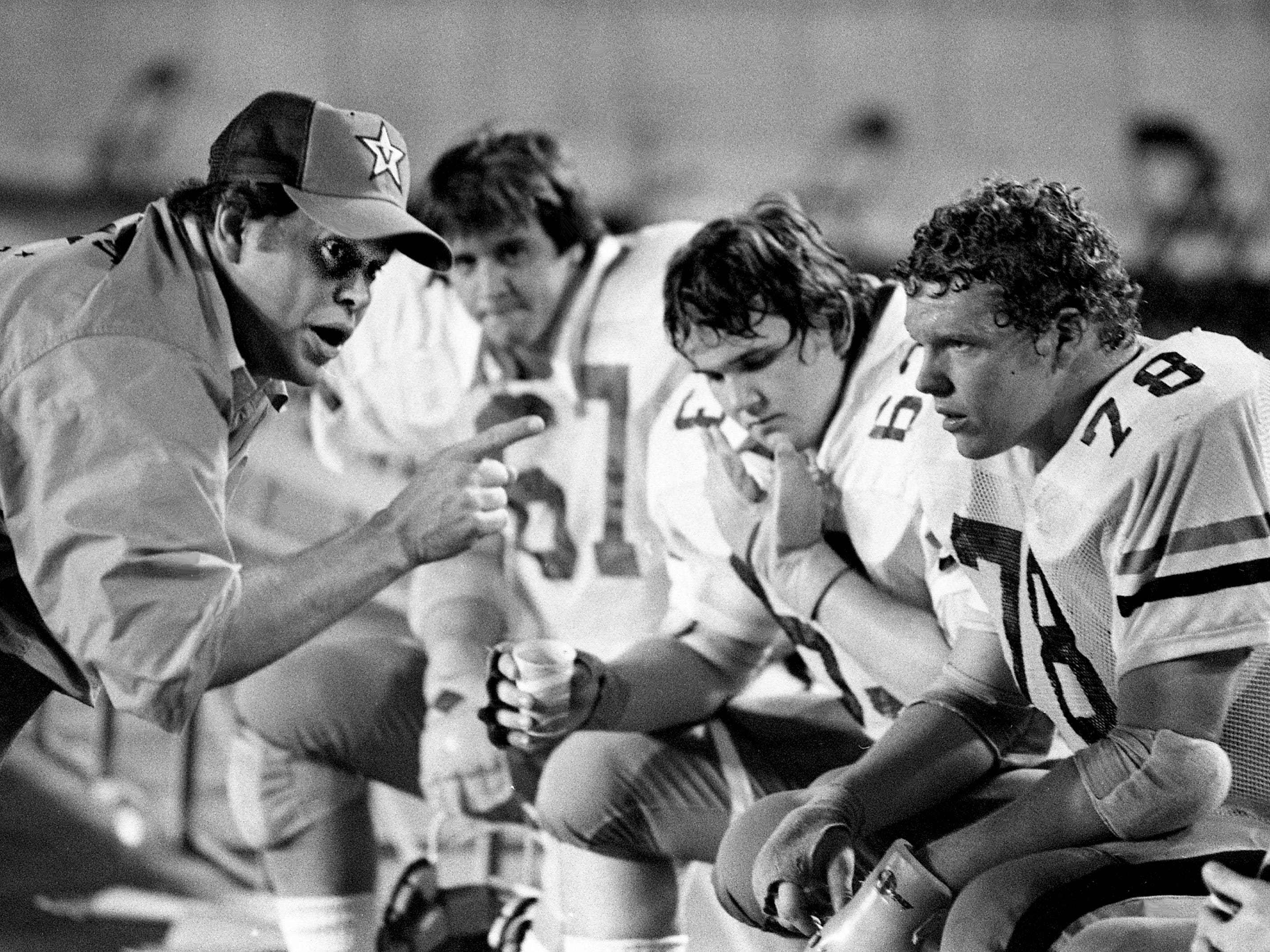 Vanderbilt assistant coach Phillip Fulmer, left, makes a point with the White Team offensive linemen Greg Simmons (67), Loie Hudgins (63) and Tommy Woodroof (78) during the Commodores' annual Vanderbilt spring football game at Dudley Field on April 21, 1979. The offensive line has shown the greatest improvement in spring work.