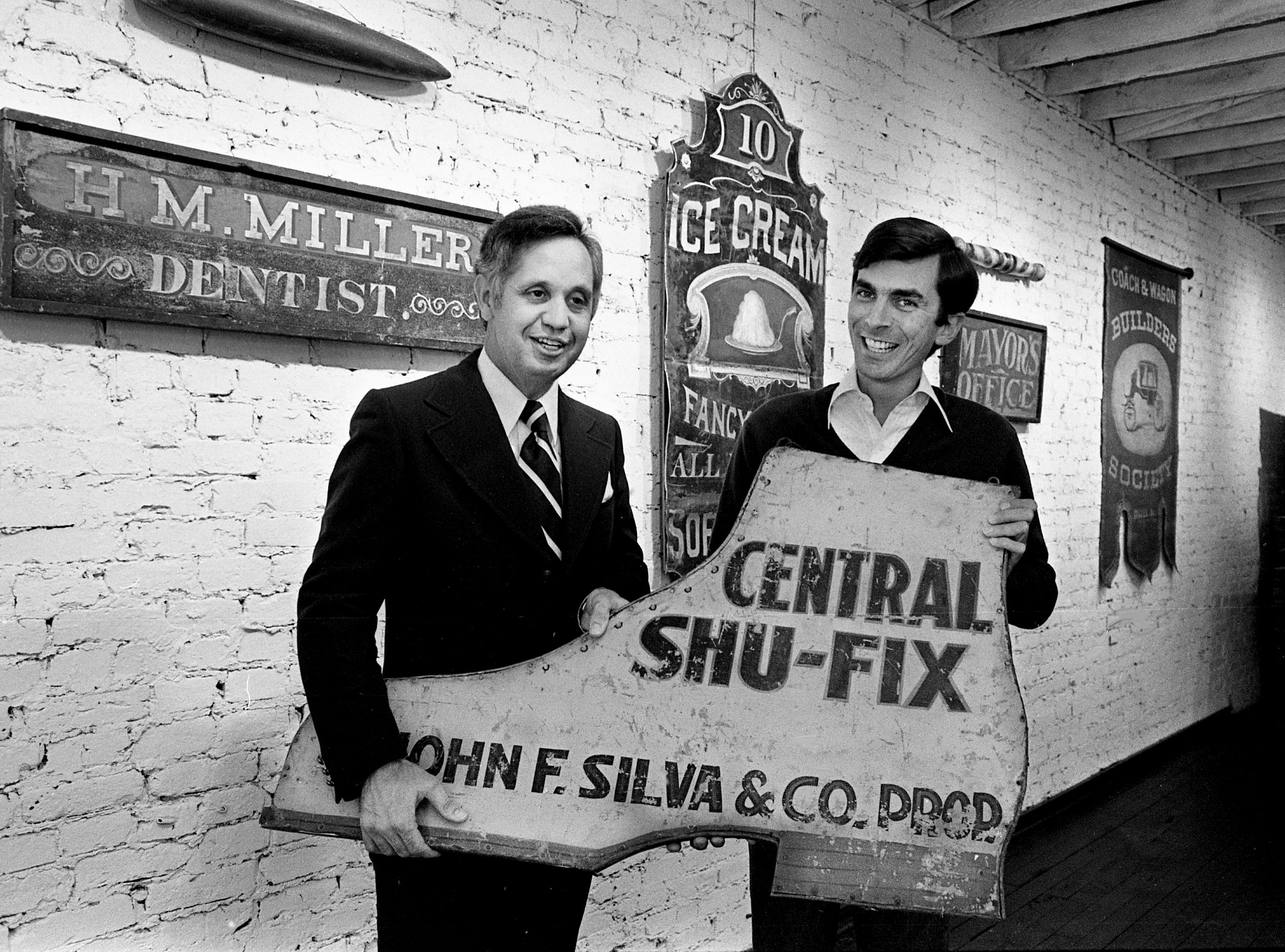 Don Early, left, and Bill Powell are installing some of the old trade signs collected by Powell at the Picture World in Franklin on April 17, 1979. The newly-formed sign advisory group of the Heritage Foundation of Franklin and Williamson County will meet the city's merchants and store owners during an open house at Picture World on May 7.