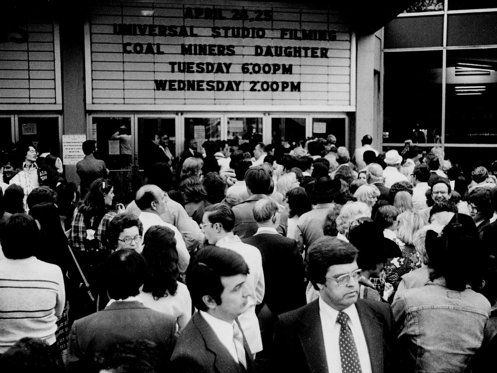 """Thousands of people crowded into Municipal Auditorium as movie extras for the filming of one of the biggest scenes in """"Coal Miner's Daughter"""" in Nashville on April 24, 1979."""