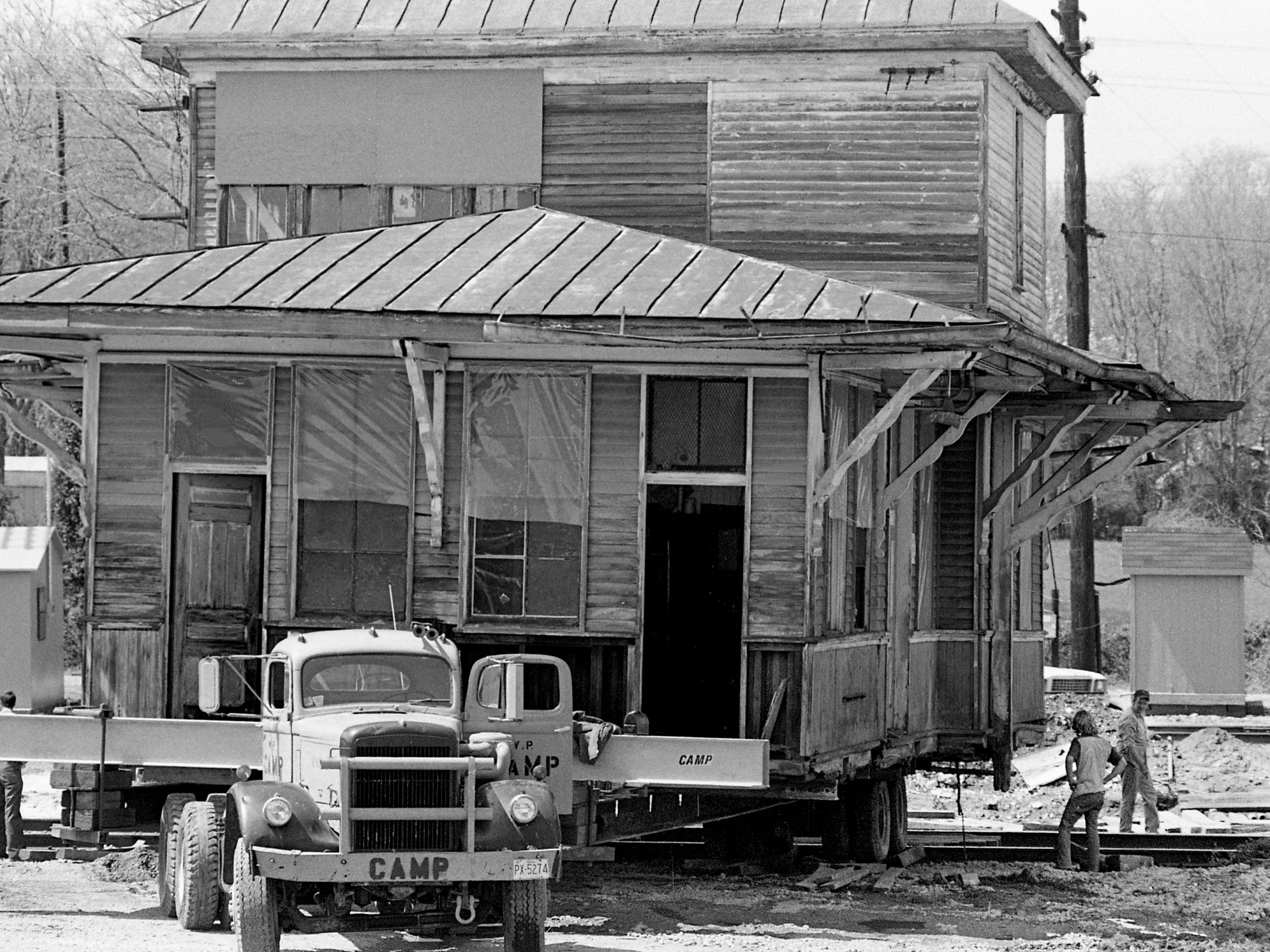 The old Amqui railroad station in Madison is being move across the L&N Railroad tracks and head toward it new home in Hendersonville on April 5, 1979. L&N officials gave the 68-year-old depot to singer Johnny Cash, a train buff, provided he pay the cost of getting it off railroad property. Cash is expected to pay $25,000 to W.P. Camp & Sons, house movers, for the job.