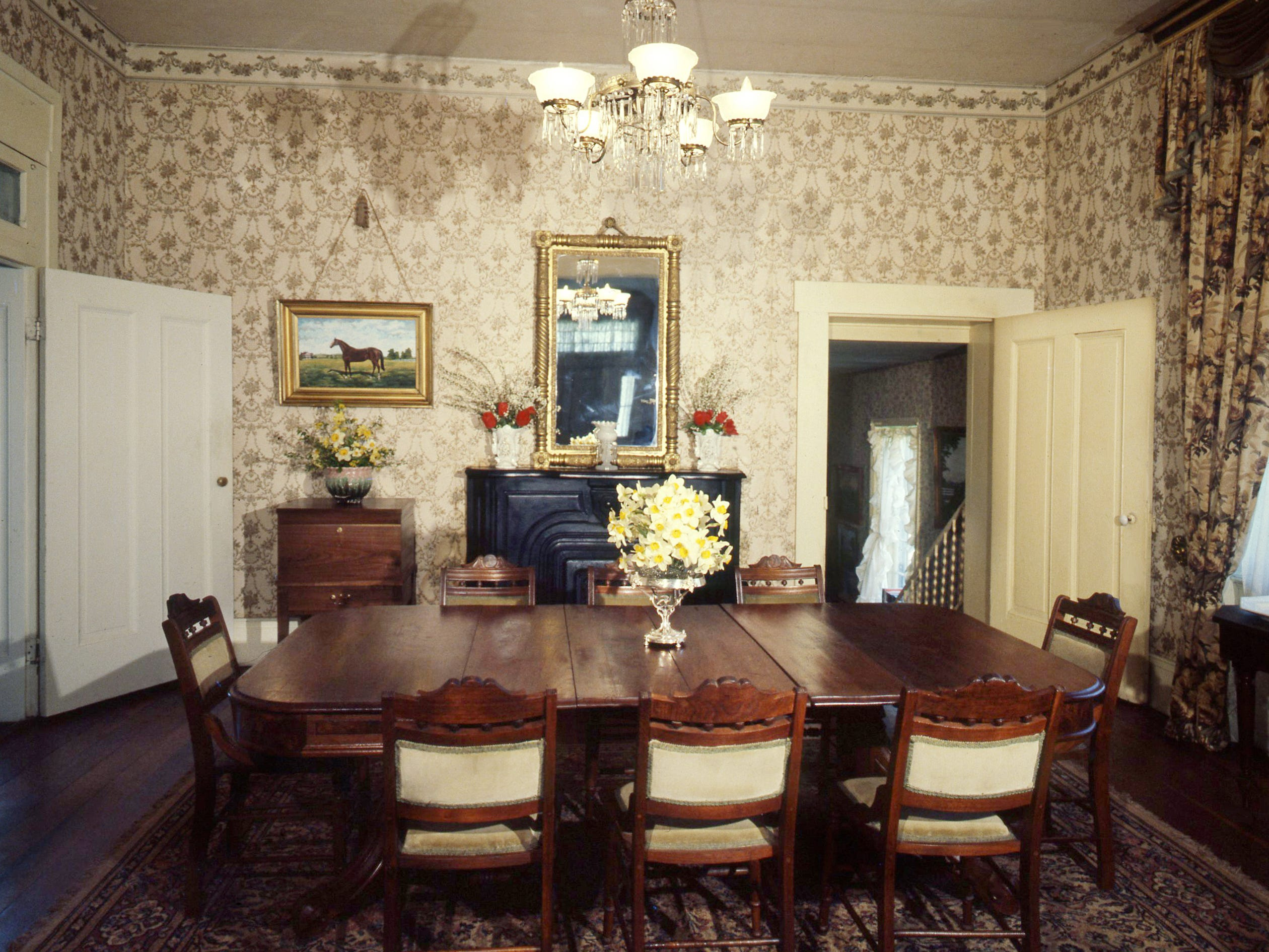 """The dining room of the """"Rosemont"""" home, pictured here on April 12, 1979, in Gallatin, was originally the back parlor with sliding doors to close it off from the front parlor. Door at left opens to the gallery hall, and the one at right leads down into a keeping-room kitchen that was the dining room when the house was built and completed in 1842 by Judge Jo Conn Guild."""