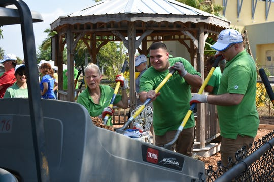 Volunteers from Publix unload mulch in April 2017, working with representatives from the Blue Zones Project and Collier County Parks and Recreation Department to rejuvenate the Community Garden at the Golden Gate Community Center.