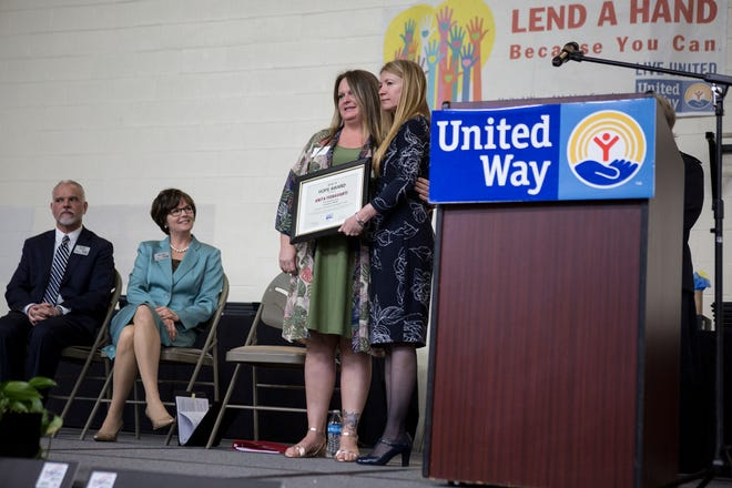 Anita Fioravanti is awarded the Hope Award at the annual United Way of Licking County breakfast by Deb Dingus, the executive director of the United Way, Licking County.