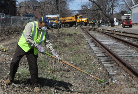 Aregawi Kishen, of the Passaic DPW, cleans an area near the intersection of Wall and 6th St. The area is known as a place where people come to do drugs and prostitution. Thursday, April, 4, 2019