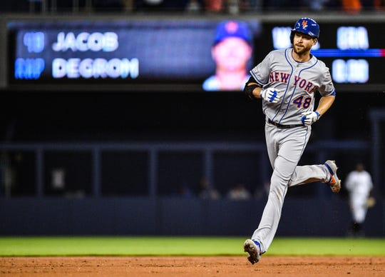 Jacob deGrom  of the New York Mets runs the bases after hitting a solo home run in the second inning against the Miami Marlins at Marlins Park on April 3, 2019 in Miami, Florida.