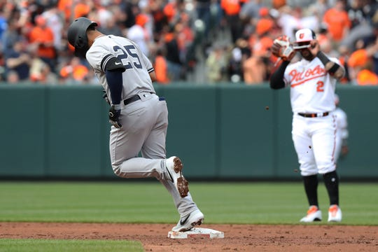 New York Yankees shortstop Gleyber Torres (25) rounds the bases after hitting a solo home run against the Baltimore Orioles at Oriole Park at Camden Yards.