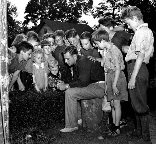 Children in Midland Park gathered around pitching marvel Johnny Vander Meer of the Cincinnati Reds on June 16, 1938, days after his second no hit, no run game in a row.