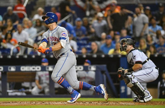 Pete Alonso of the New York Mets doubles for an rbi in the second inning against the Miami Marlins at Marlins Park on April 3, 2019 in Miami, Florida.