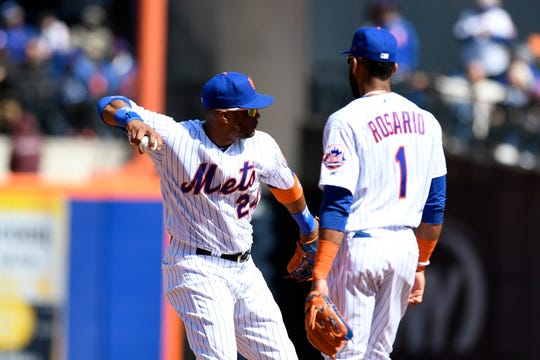New York Mets second baseman Robinson Cano (24) and New York Mets shortstop Amed Rosario (1) warm up before the third inning during the Mets home opener against the Washington Nationals on Thursday, April 4, 2019, in Flushing, NY.