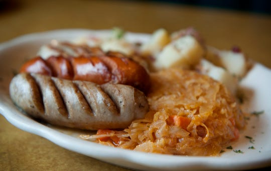 Bavarian sausage platter, knockwurst, bratwurst and a weisswurst, with potato salad and homemade sauerkraut at Kirker's Inn in Hawthorne.
