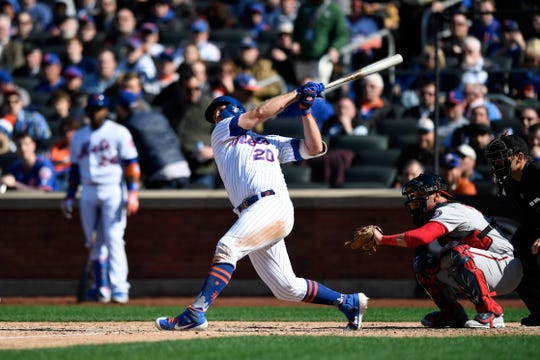 New York Mets first baseman Pete Alonso (20) strikes out in the eighth inning. The New York Mets lose their home opener against the Washington Nationals, 4-0, on Thursday, April 4, 2019, in Flushing, NY.