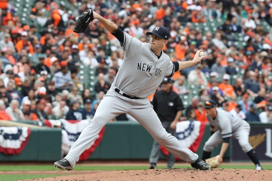 New York Yankees pitcher James Paxton (65) pitches against the Baltimore Orioles at Oriole Park at Camden Yards.