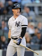 Clint Frazier (77) of the New York Yankees reacts after striking out in the ninth inning against the Detroit Tigers at Yankee Stadium on April 03, 2019 in the Bronx borough of New York City.