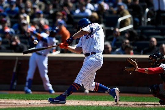 New York Mets first baseman Pete Alonso (20) connects for a single in the second inning during the Mets home opener against the Washington Nationals on Thursday, April 4, 2019, in Flushing, NY.