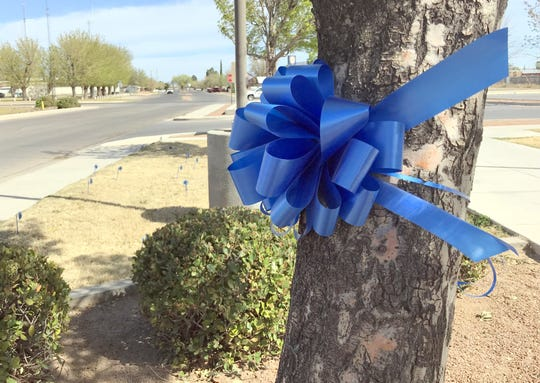 Blue ribbons and blue pinwheels adorn the front entrance to the Sixth Judicial District Courthouse at 855 S. Platinum Avenue as a reminder for April as National Child Abuse Awareness and Prevention Month.