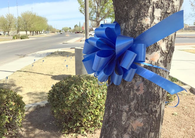 Blue ribbons and blue pinwheels were placed at the front entrance to the Sixth Judicial District Courthouse at 855 S. Platinum Avenue in 2019 as a reminder for April as National Child Abuse Awareness and Prevention Month.