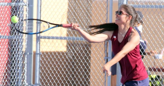 Senior Lady 'Cat Rosa Villagrana stretches for the baseline shot during her singles match on Tuesday against Tara Ramos of Las Cruces High. Villagrana scored a 6-1 and 6-0 victory.