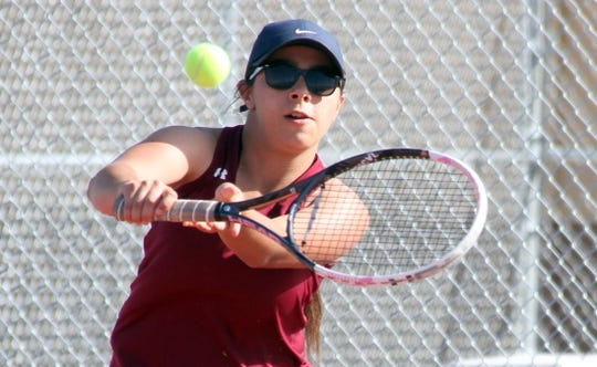 Senior Lady 'Cat Katelyn Seats led a strong charge by the Deming High girls' varsity tennis team during Tuesday's 6-0 District 3-5A dual match win over the visiting Las Cruces High Bulldawgs.