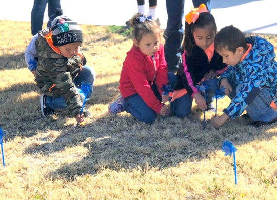 Children were busy planting blue pinwheels in Deming to bring attention to April as National Child Abuse Awareness and Prevention Month.