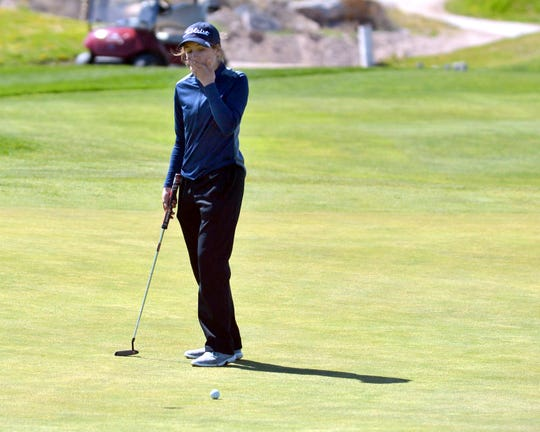 Sophomore Kamryn Zachek reacts to her first putt coming up short on No. 14 on Monday morning at this year's Dona Ana Invitational Golf Tournament.