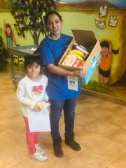 Jardin de los Niños' family receives a healthy and nutritious box of food through the support of the weekend anti-hunger project.