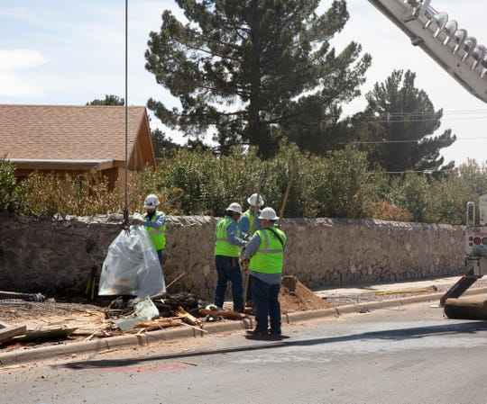 El Paso Electric crews work to remove an electrical transformer Thursday, April 4, 2019, after a vehicle plowed into an electrical pole at the intersection of Frank Maez and Spitz Street in Las Cruces.