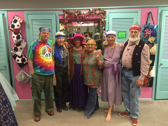 Members of PFLAG Silver City gather at Vintage Fantasies in their Woodstock attire.