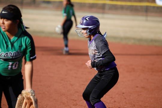 Kirtland Central's Lanae Ben looks to take off from first base against Farmington during a non-district game on Tuesday, March 5 at Ricketts Softball Complex in Farmington.