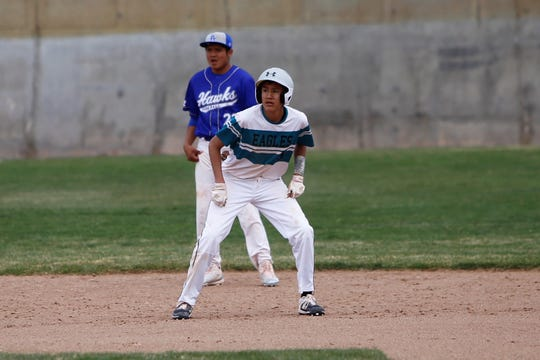 Navajo Prep's Ryan Montanez looks to take off toward third base against Laguna Acoma during Thursday's game at Farmington Sports Complex.