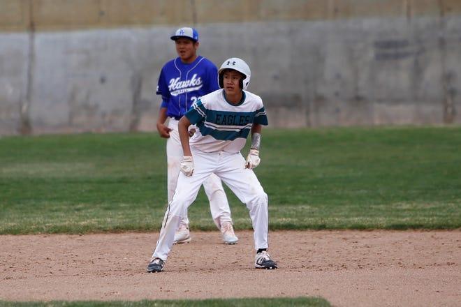 Navajo Prep's Ryan Montanez looks to take off toward third base against Laguna Acoma during Thursday's game at Farmington Sports Complex.