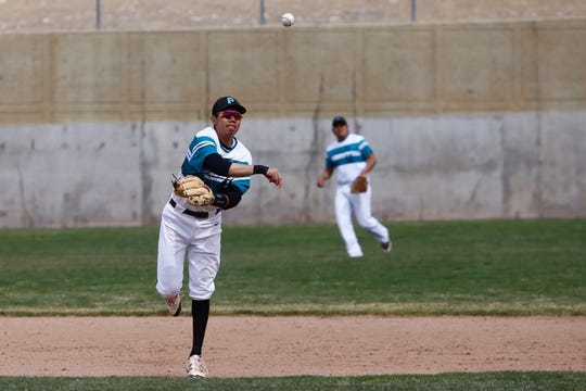 Navajo Prep's Thomas Montanez throws to first base for an out against Laguna Acoma during Thursday's District 1-3A game at Farmington Sports Complex. Visit daily-times.com to see the latest sports photo galleries and video highlights.