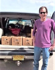Todd Russell gets ready to unload his donation.