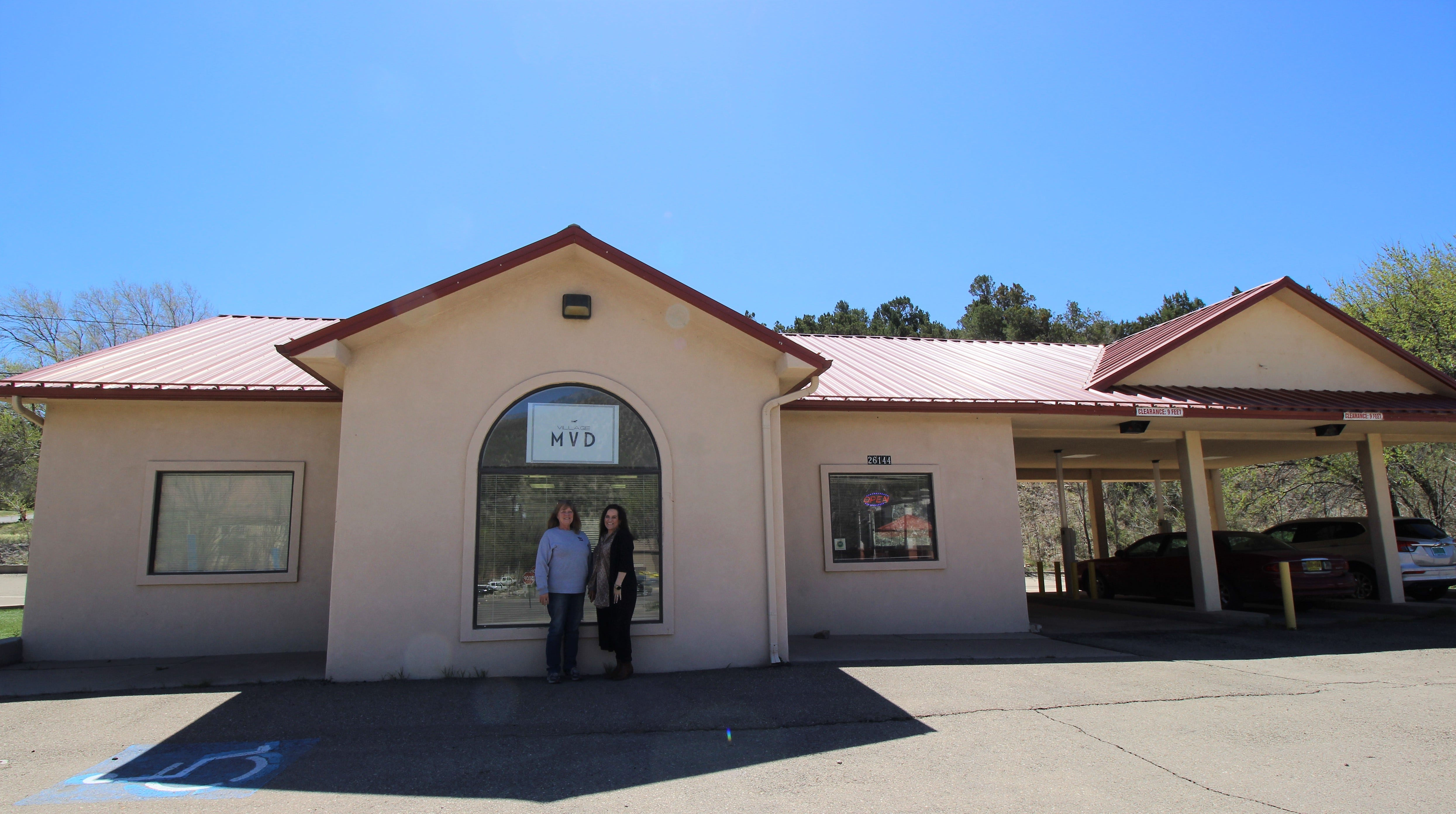 Debbie Heineken, title clerk specialist, and owner Shelly McNutt stand in front of the new Village MVD that opened in March on Highway 70 in Ruidoso Downs.