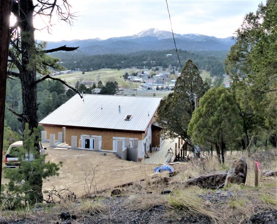 A new house is being built on Coronado Drive with an spectacular view of Sierra Blanca Peak and Cree Meadows Golf Course.