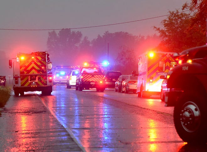 Firefighters and first responders at the scene of a church fire Thursday.
