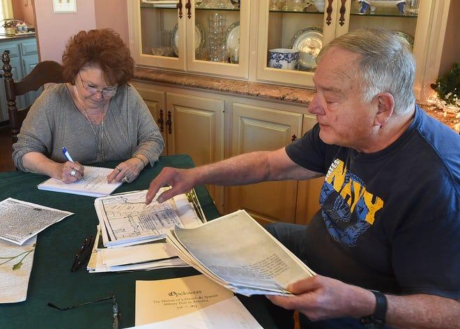 Carola Hartley and Robert Tomlinson reviewing notes.