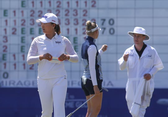 Jin Young Ko, left, finishes her round on the 18th hole at the ANA Inspiration at Mission Hills Country Club in Rancho Mirage, April 4, 2019.