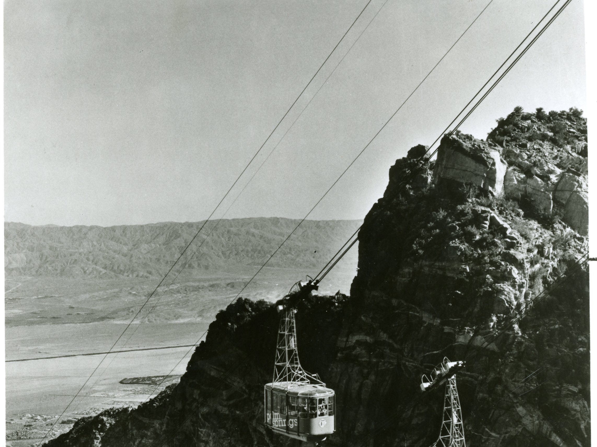 Two early tram cars pass en route to their respective stations in this undated Palm Springs Aerial Tram photo.