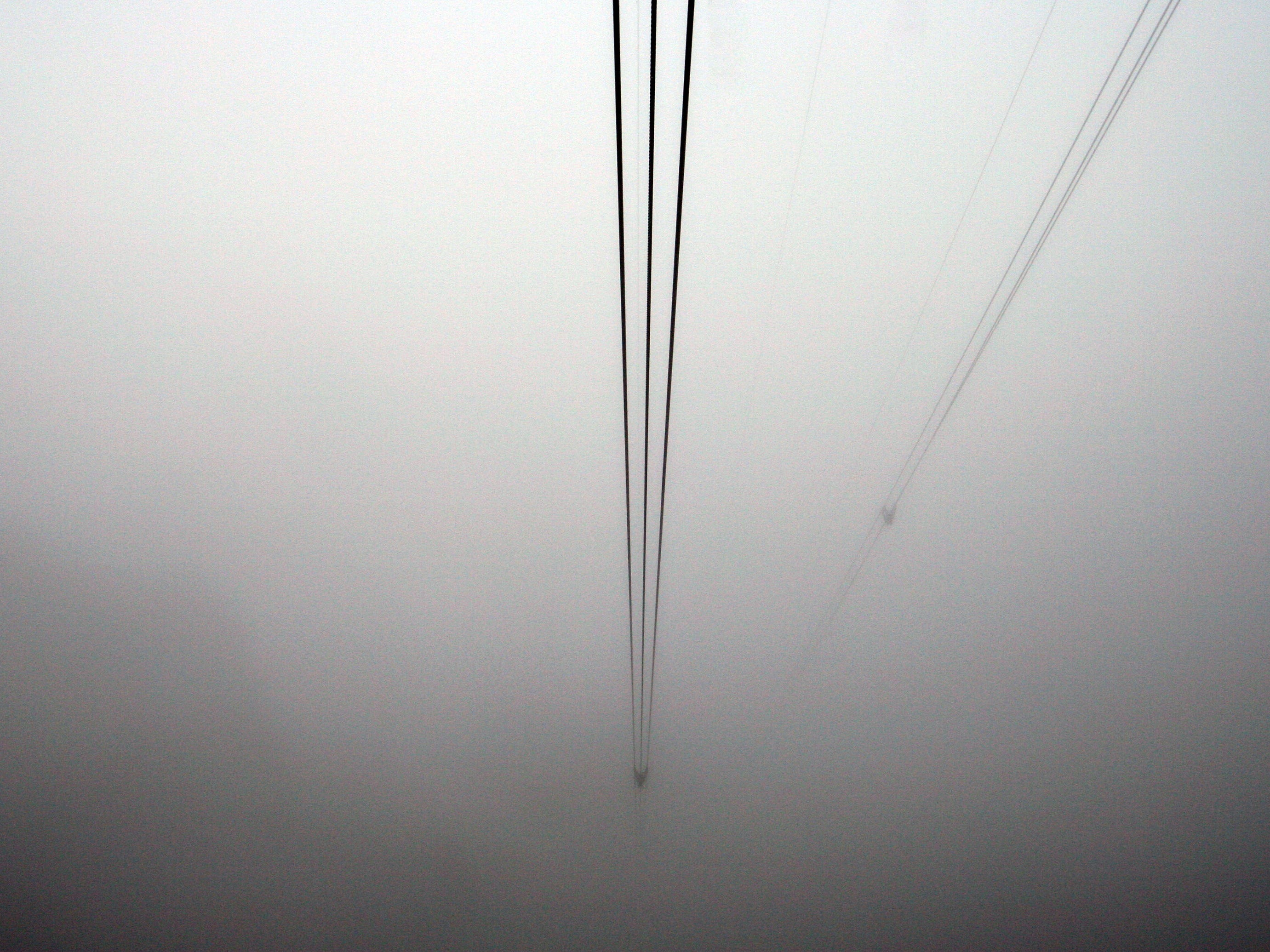 This December 2010 photo shows clouds engulfing cables that are used by the Palm Springs Aerial Tramway.