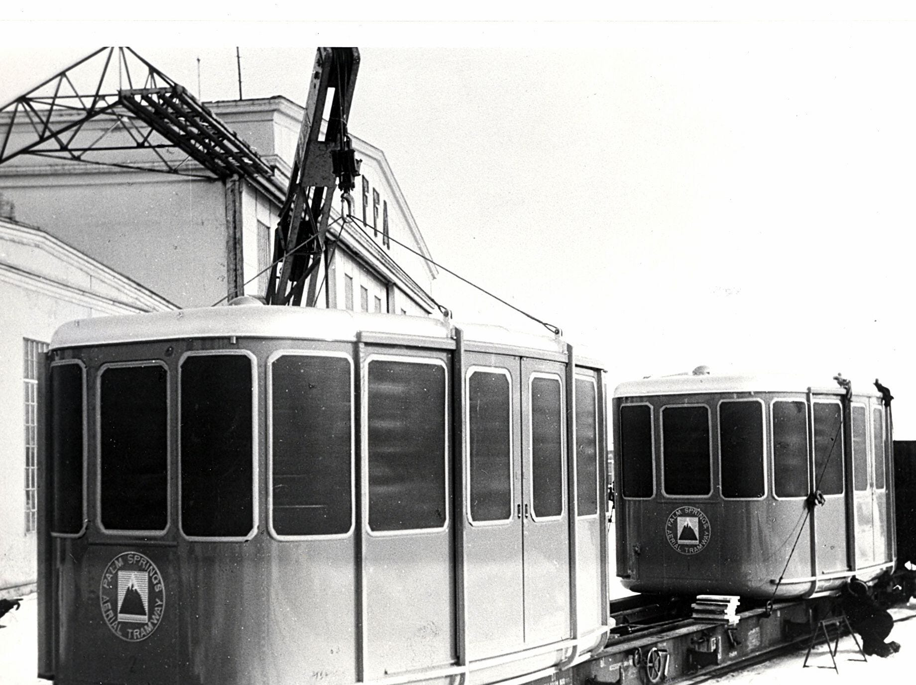This undated photo shows two new tram cars arrive at the Palm Springs Aerial Tramway during its early days.