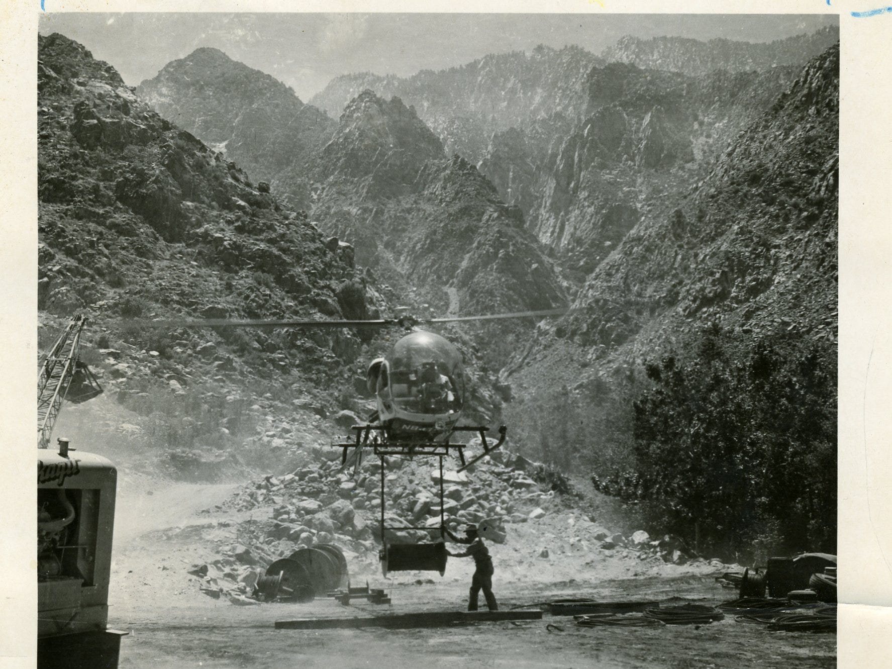 A helicopter moves supplies to build the tram structures in this undated Palm Springs Aerial Tram photo.