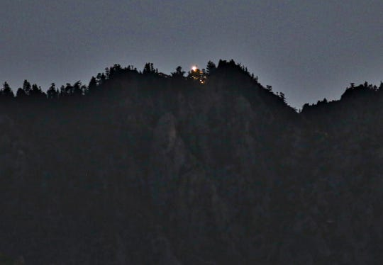 This August 2014 file photo shows the Palm Springs Aerial Tramway's mountain station light, which is visible from the Coachella Valley floor. Tram officials say the light is now blue as a tribute to essential workers during the coronavirus pandemic.