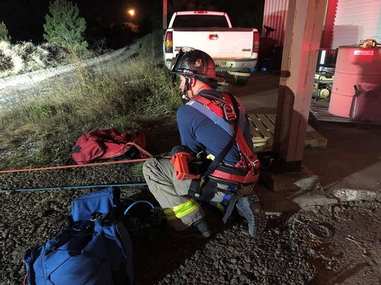 Escambia County Fire Rescue workers rescued a 15-year-old from a 75-foot deep sand pit on Wednesday night.