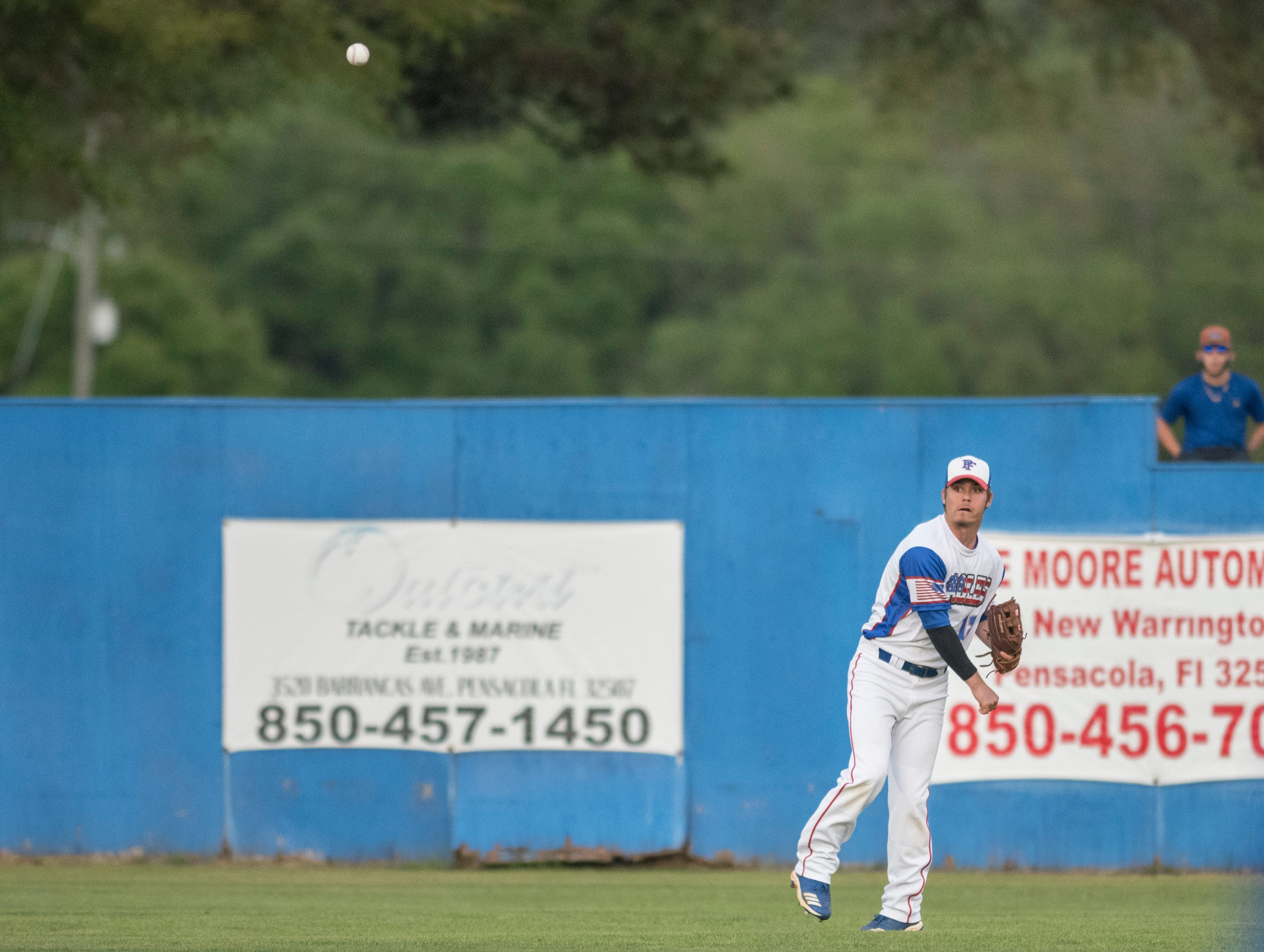 Nolan Rigby (12) tosses the ball back into the infield after making the play during the Christian Educational Consortium vs Pine Forest baseball game at Pine Forest High School in Pensacola on Wednesday, April 3, 2019.