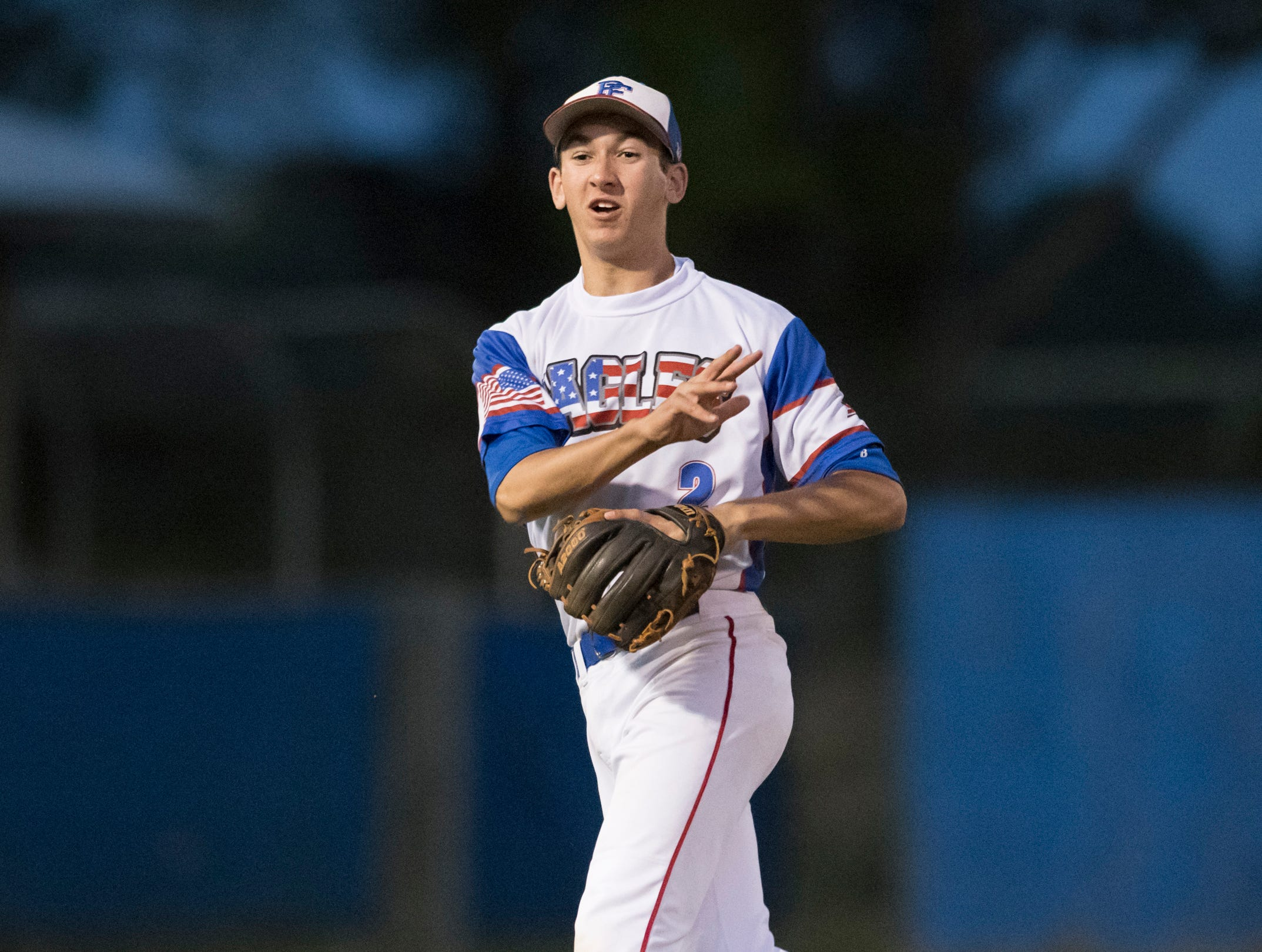 Second baseman John Pinette (2) tosses to first but is a little too late for the out during the Christian Educational Consortium vs Pine Forest baseball game at Pine Forest High School in Pensacola on Wednesday, April 3, 2019.