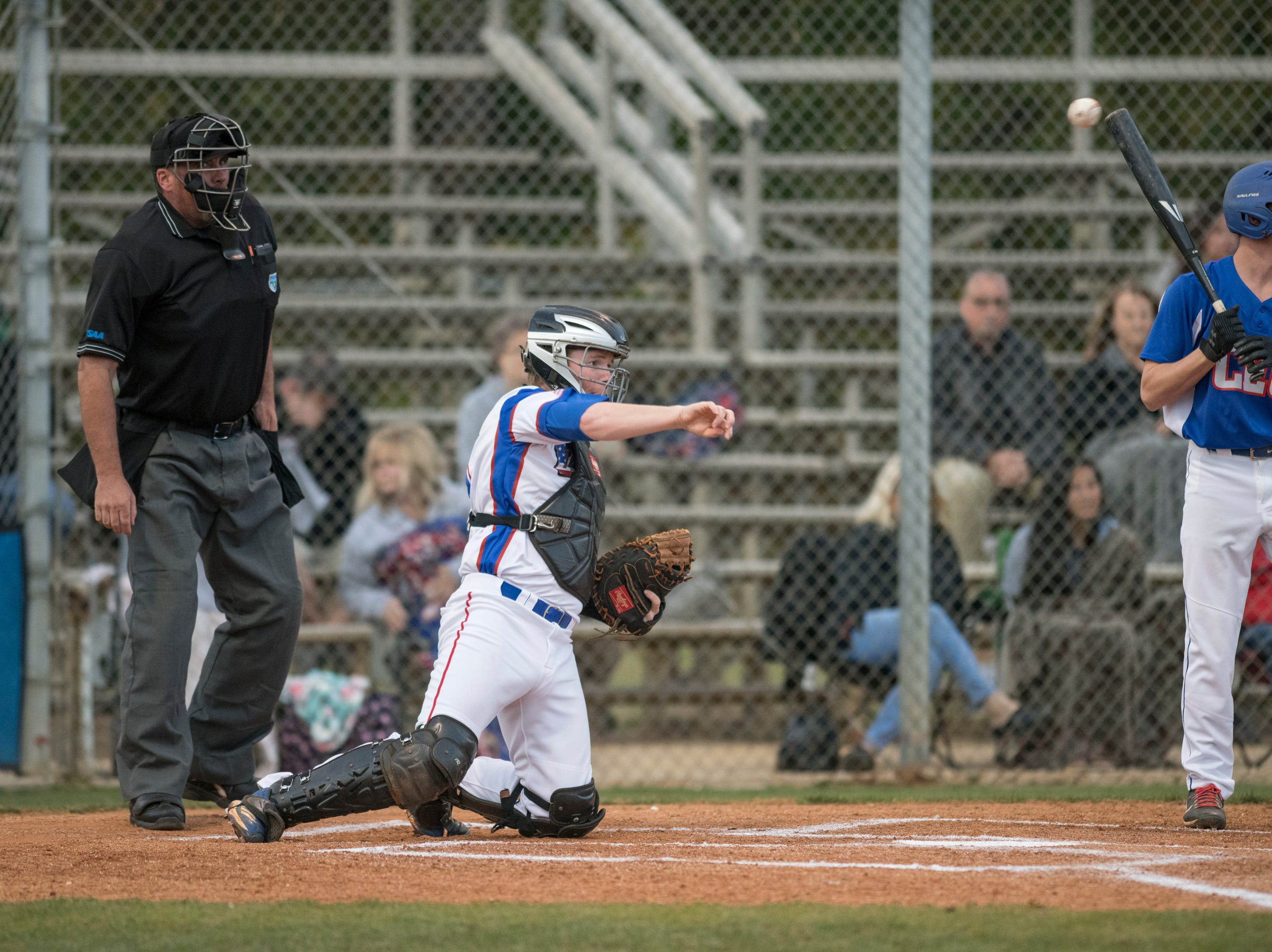Catcher Jason Roberts (15) tosses the ball back to the pitcher during the Christian Educational Consortium vs Pine Forest baseball game at Pine Forest High School in Pensacola on Wednesday, April 3, 2019.
