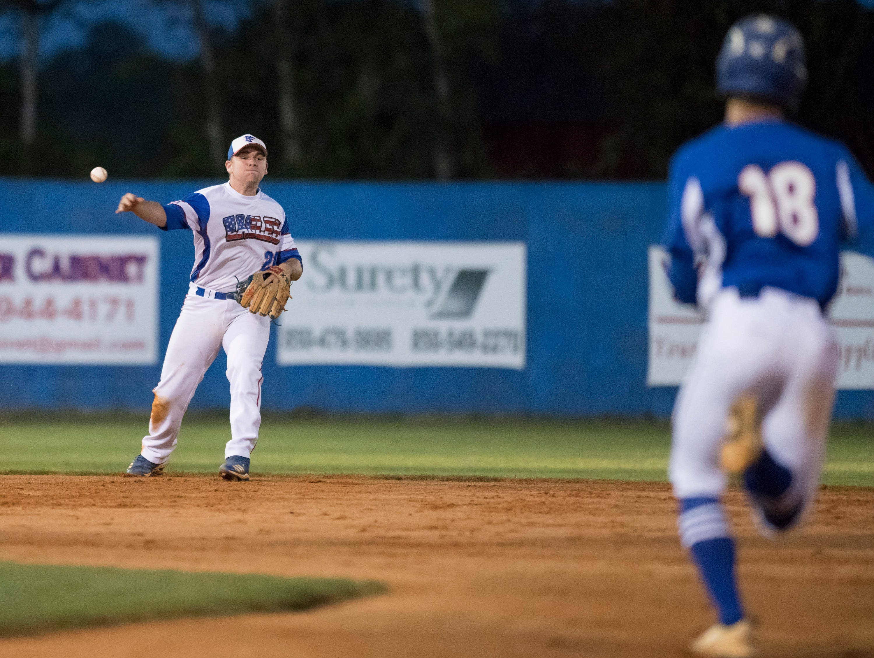 Shortstop Timmy Williams (20) tosses to second for the third out in the top of the 2nd inning during the Christian Educational Consortium vs Pine Forest baseball game at Pine Forest High School in Pensacola on Wednesday, April 3, 2019.