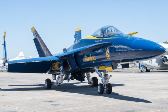 A Blue Angels F/A-18 Hornet is on display April 2 on the flight line at the National Naval Aviation Museum at Naval Air Station Pensacola. The Navy hopes to transition the Blue Angels to the F/A-18 Super Hornet in time for the 2021 air show.